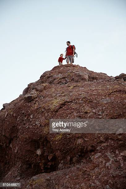 Father and son on top of a mountain