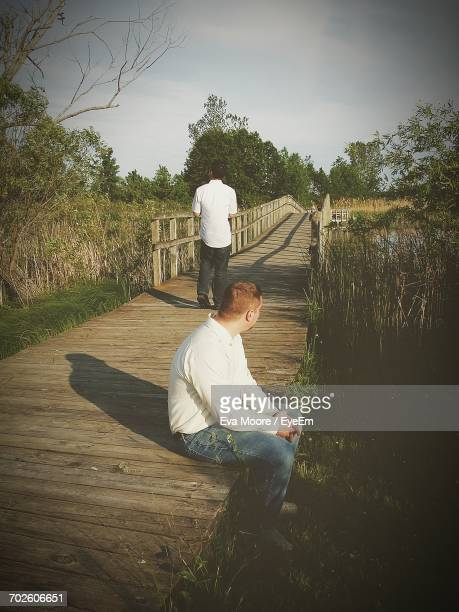 Father And Son On Walkway