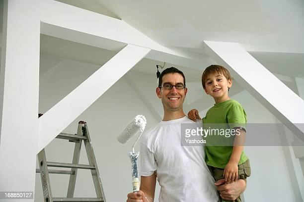 Father and son painting new house