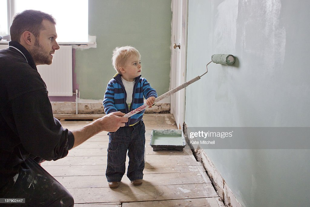 Father and son painting wall : Stock Photo