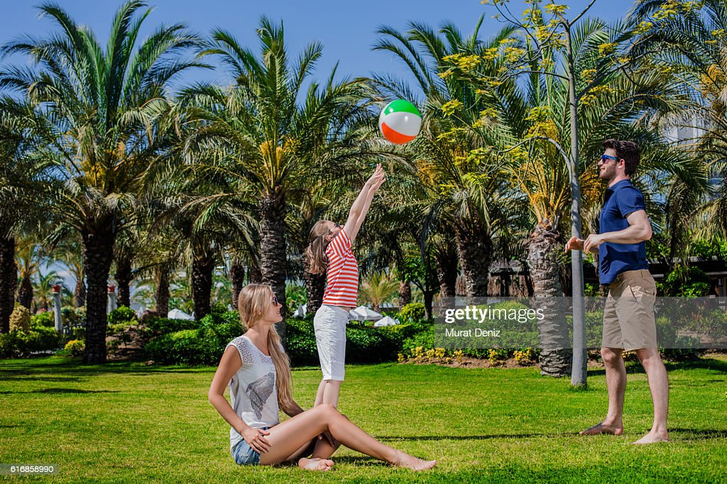 Father and son palying ball together in the garden : Stock Photo