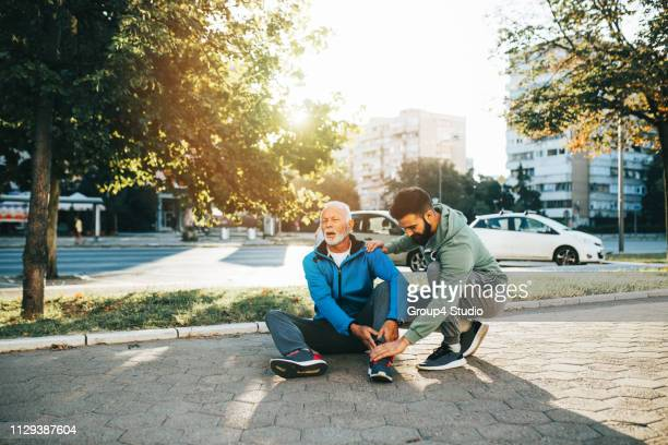 father and son - falling stock pictures, royalty-free photos & images