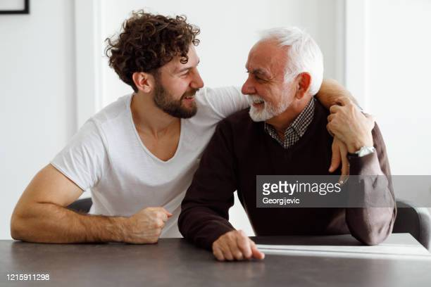 father and son - respect stock pictures, royalty-free photos & images
