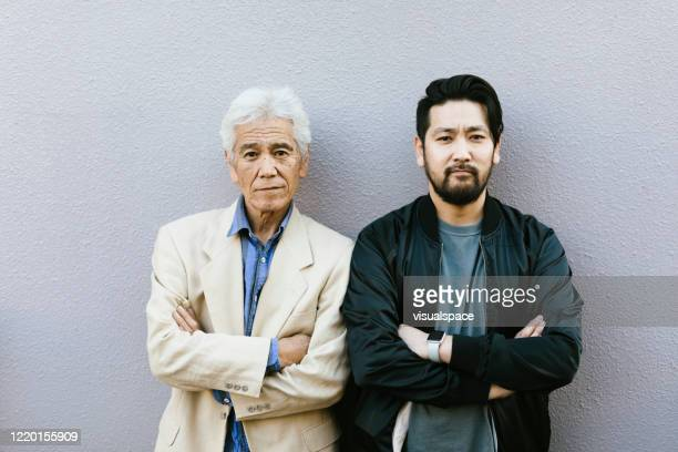 father and son - authority stock pictures, royalty-free photos & images