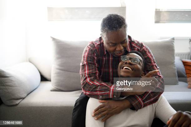 father and son - african american culture stock pictures, royalty-free photos & images