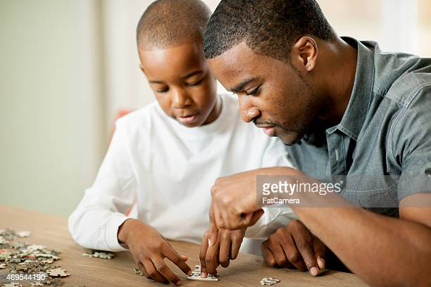 father and son - game night stock photos and pictures