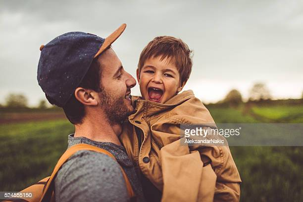father and son - multi colored hat stock pictures, royalty-free photos & images