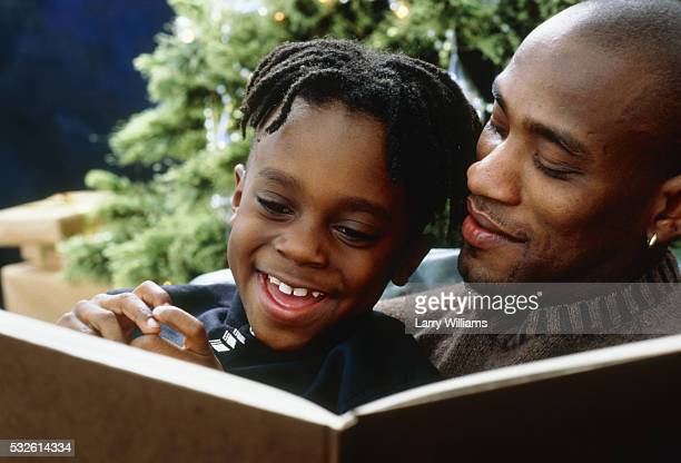 father and son - african american christmas images stock pictures, royalty-free photos & images