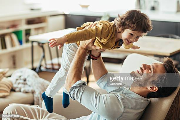 father and son - picking up stock pictures, royalty-free photos & images