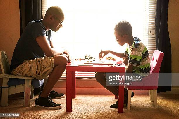 father and son - chequers stock photos and pictures
