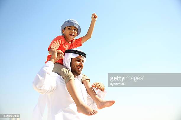father and son - arabia stock pictures, royalty-free photos & images