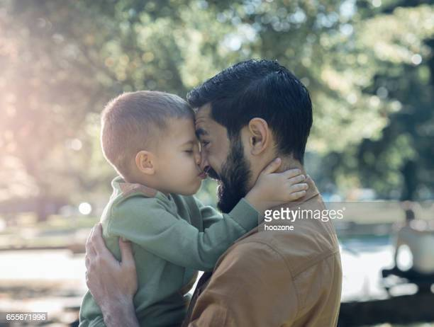 father and son - halfback american football player stock pictures, royalty-free photos & images
