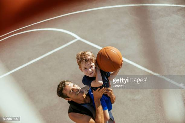 father and son - basketball sport stock pictures, royalty-free photos & images