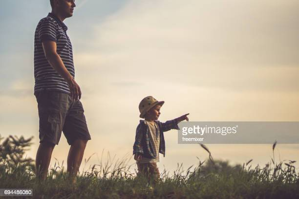 father and son - moving after stock pictures, royalty-free photos & images