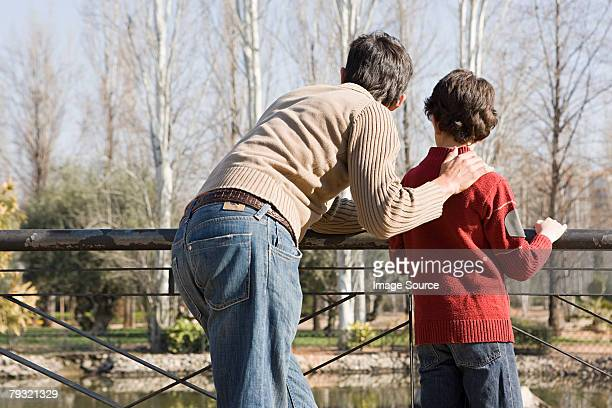 father and son - hand on shoulder stock pictures, royalty-free photos & images