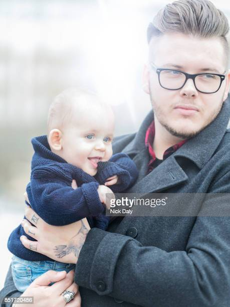 father and son - thick rimmed spectacles stock photos and pictures