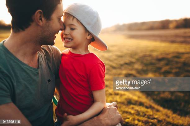 father and son - softball sport stock pictures, royalty-free photos & images