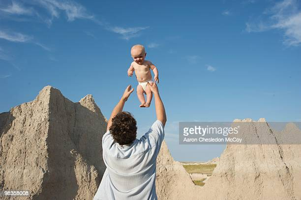 father and son - bare breasted babes stock pictures, royalty-free photos & images