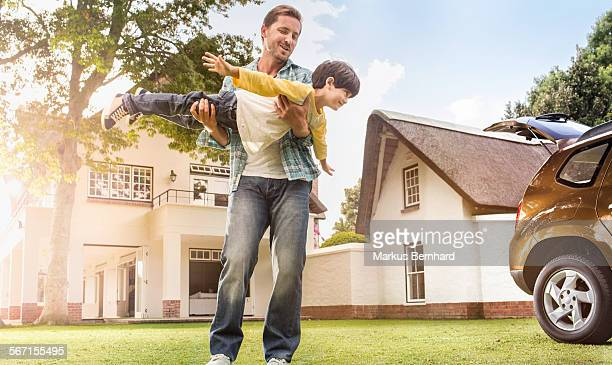 Father and son play airplane