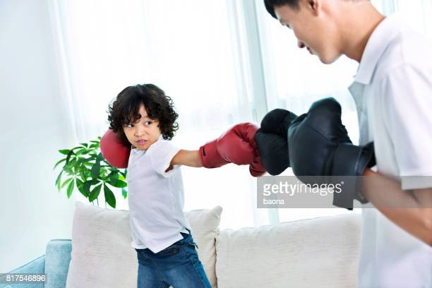 Father and son play boxing
