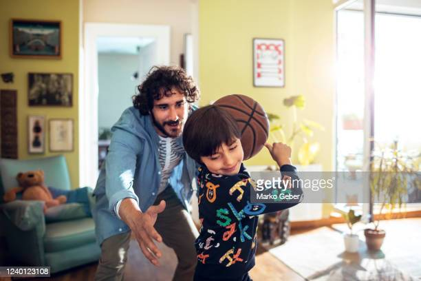 father and son playing around - genderblend stock pictures, royalty-free photos & images