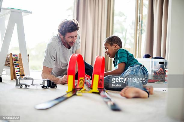 Father and son playing at home