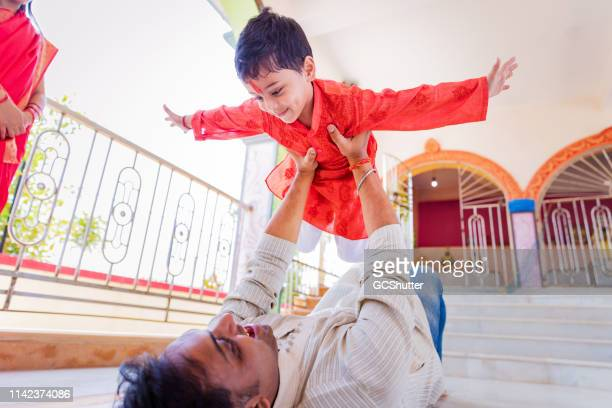 father and son playing at the temple - the god father stock photos and pictures