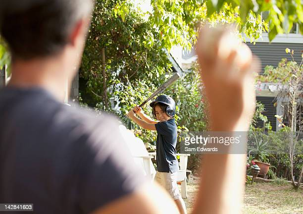 Father and son playing baseball outdoors