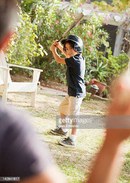 father and son playing baseball outdoors - バッティング ストックフォトと画像