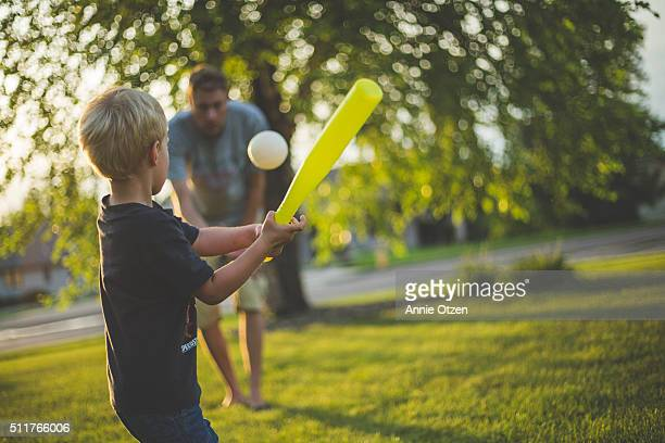 father and son playing baseball - baseball sport stock pictures, royalty-free photos & images