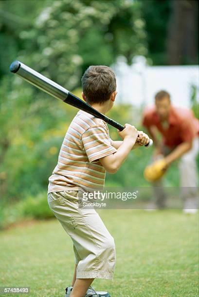 Father and son playing baseball