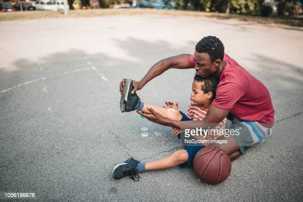 father and son playing basketball - bandage stock pictures, royalty-free photos & images