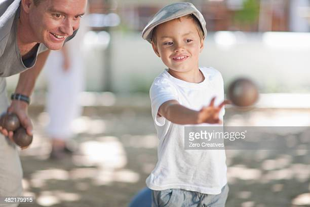 Father and son playing boules