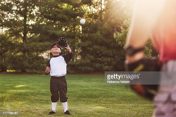 father and son playing catch - rebecca nelson stock pictures, royalty-free photos & images