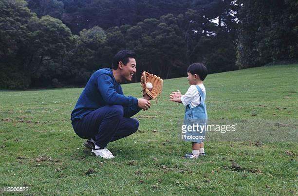 Father and Son Playing Catch