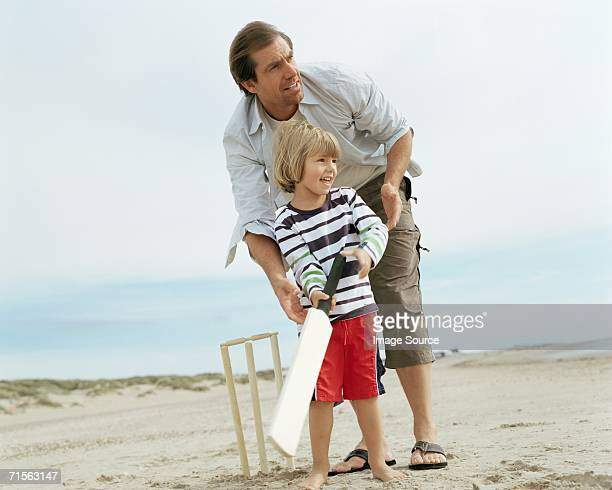Father and son playing cricket