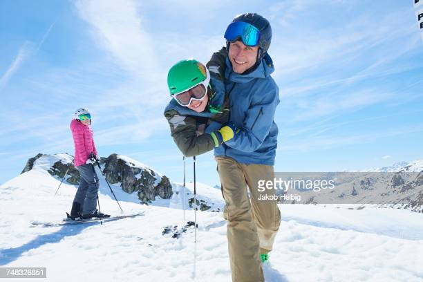 Father and son playing, Hintertux, Tirol, Austria