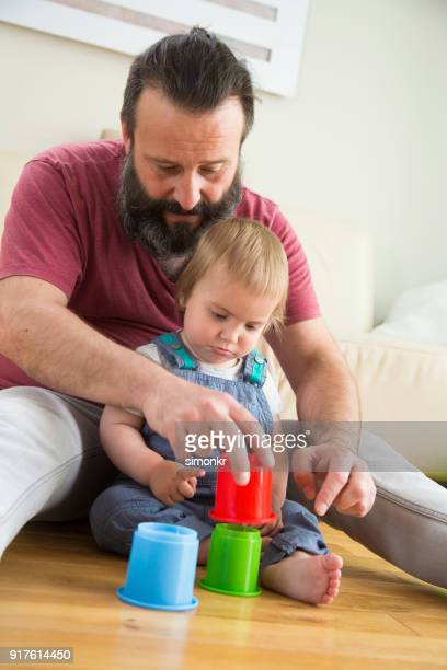 Father and son playing in living room