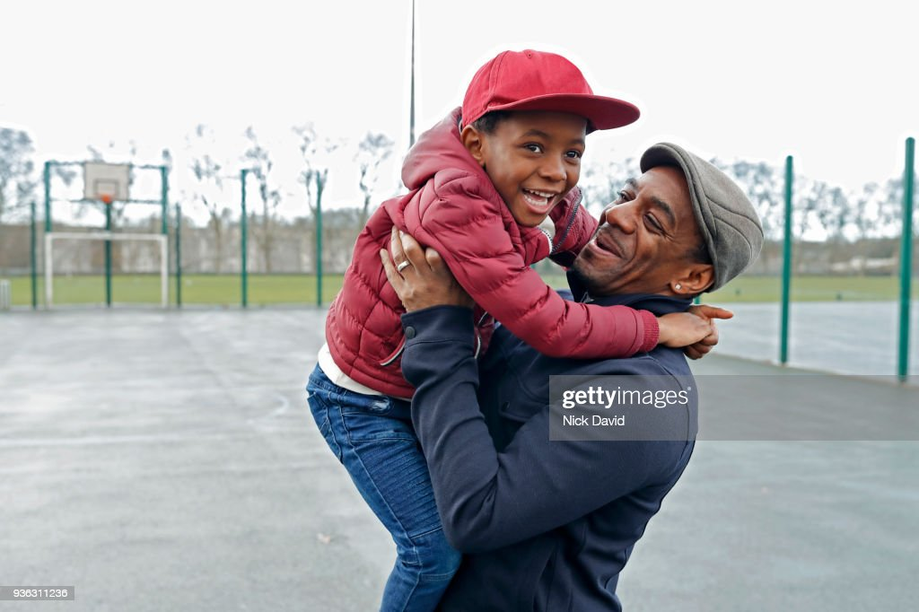 Father and son (4-5) playing in park : Stock Photo