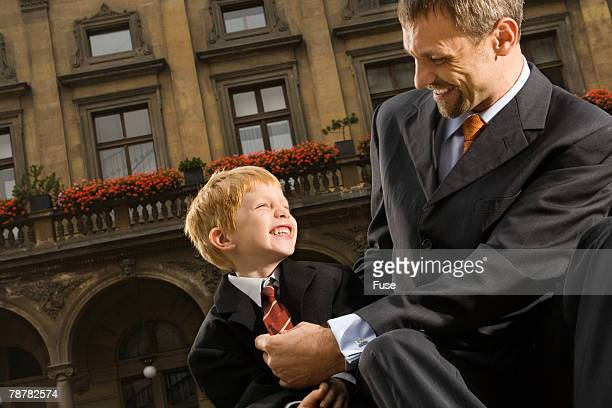 Father and Son Playing in Square