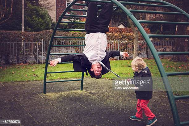 Father and son playing in the park together