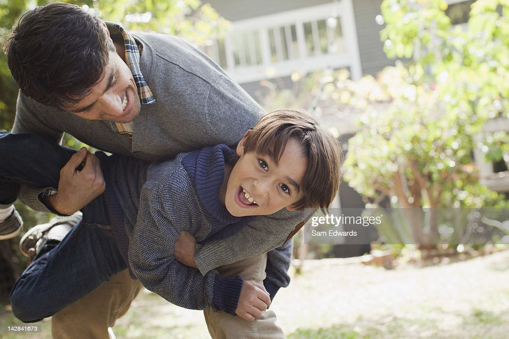 Father and son playing outdoors : Stock Photo