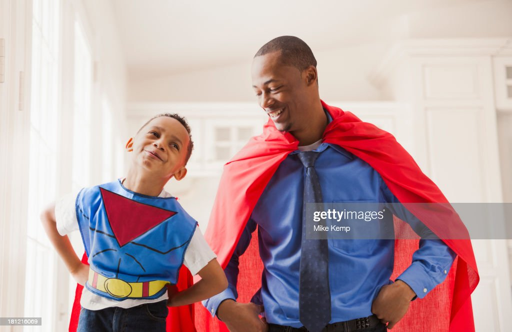 Father and son playing superhero : Stock Photo