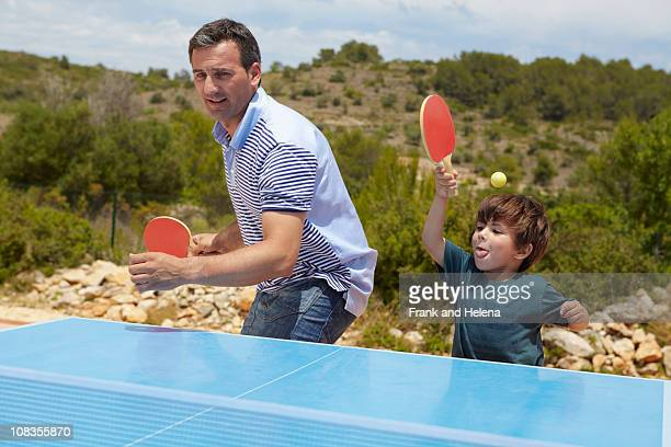 father and son playing table tennis - doubles stock pictures, royalty-free photos & images