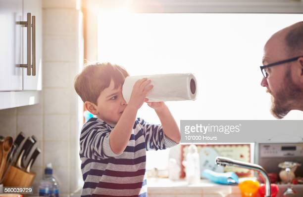 father and son playing the kitchen - finding stock photos and pictures
