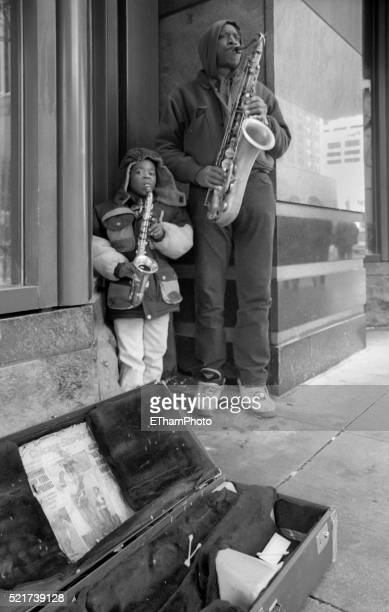 Father and son playing the saxophone on Michigan Ave., Chicago (1997)