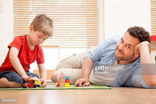 Father and son playing together in the nursery