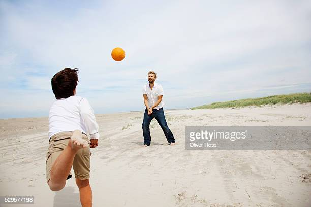 Father and son playing volleyball