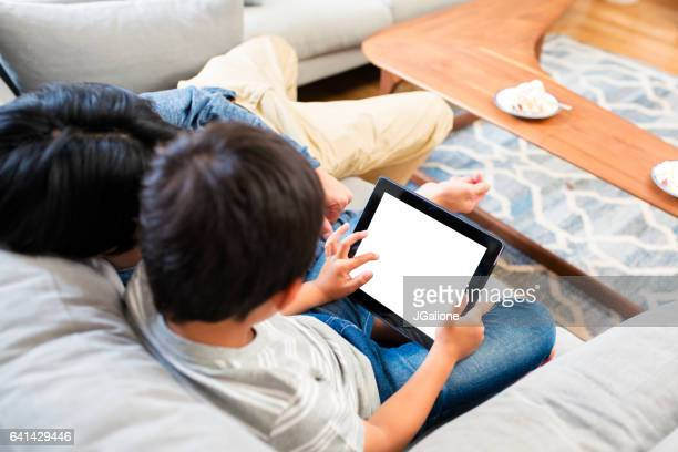 Father and son playing with a digital tablet together