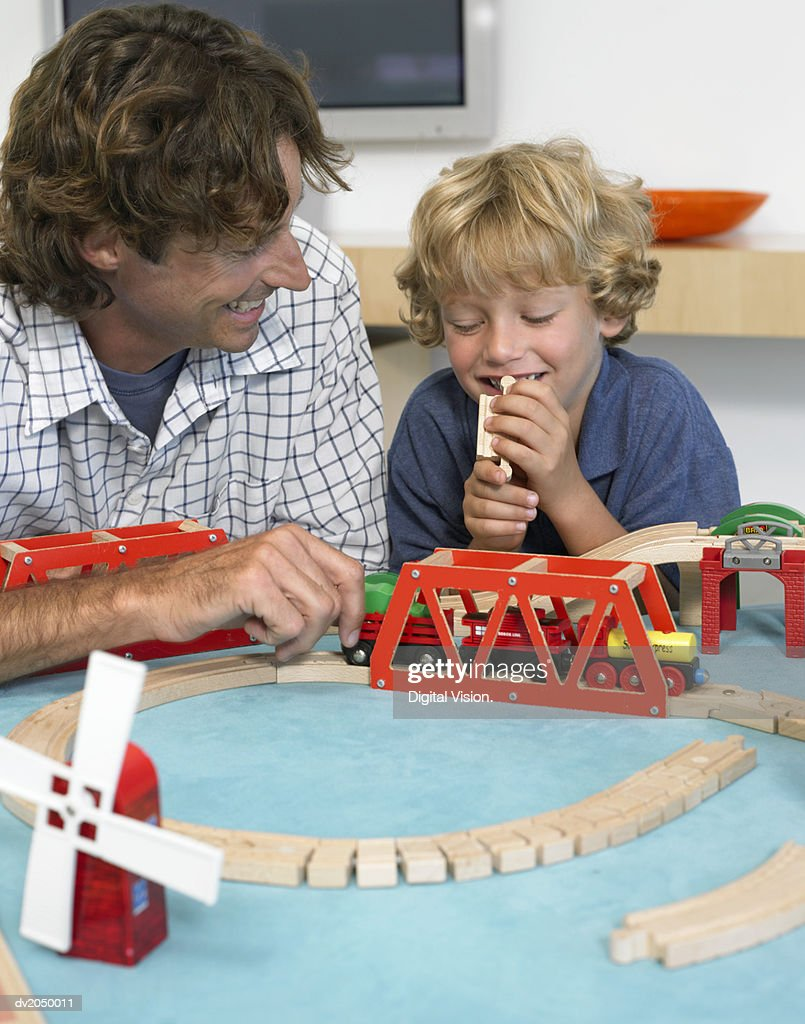 Father and Son Playing With a Toy Train : Stock Photo